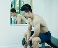 Asian sport man ,asian man with dumbbell weight training equipment Royalty Free Stock Photos