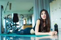 Asian sport woman walking or running on treadmill equipment in f. Itness workout gym. Sport and Beauty concept. Workout and Strength Training theme. Cardio and Royalty Free Stock Image