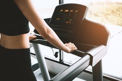 Asian sport woman walking or running on treadmill equipment in f stock image