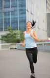Asian sports woman running in city Stock Photos