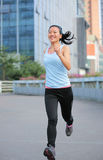 Asian sports woman running in city Stock Image