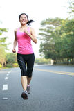Asian sports woman running in city Stock Photography
