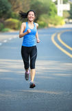 Asian sports woman running in city Royalty Free Stock Image