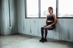 Asian sportswoman doing workout for endurance power legs. Beside a windows stock photos