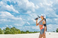 Sportswoman with sport bottle royalty free stock photo