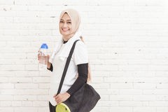 Asian sporty woman carrying sports bag anf a bottle of water Royalty Free Stock Photography