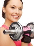 Asian sporty woman with heavy dumbbell Stock Images