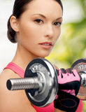 Asian sporty woman with heavy dumbbell Royalty Free Stock Image