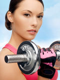 Asian sporty woman with heavy dumbbell Stock Photo