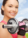 Asian sporty woman with heavy dumbbell Royalty Free Stock Photos