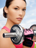 Asian sporty woman with heavy dumbbell Stock Photography