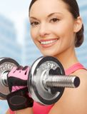 Asian sporty woman with heavy dumbbell Stock Photos