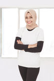 Asian sporty woman wearing hijab with armcrossed Stock Images