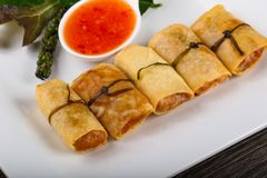 Asian spring roll. Traditional Asian spring roll with shrimps and vegetables royalty free stock photography