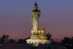Asian standing Big Buddha after sunset Royalty Free Stock Image