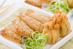 Asian Starters. Fried wontons, prawn toast and spring rolls Stock Photography