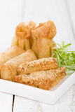 Asian Starters. Fried wontons, prawn toast and spring rolls served with sweet chili sauce Royalty Free Stock Image