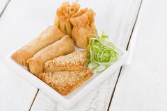Asian Starters. Fried wontons, prawn toast and spring rolls served with sweet chili sauce Stock Photos