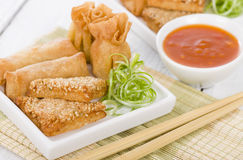 Asian Starters. Fried wontons, prawn toast and spring rolls served with sweet chili sauce Stock Photo