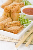 Asian Starters. Fried wontons, prawn toast and spring rolls served with sweet chili sauce Royalty Free Stock Photography