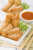 Asian Starters. Fried wontons, prawn toast and spring rolls served with sweet chili sauce Royalty Free Stock Photos