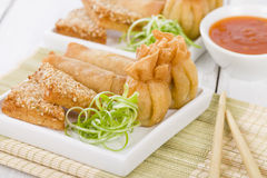 Asian Starters. Fried wontons, prawn toast and spring rolls served with sweet chili sauce Stock Images