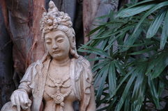Asian statue. In a courtyard of hotel in Oahu stock images