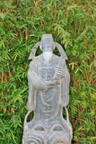 Asian Statue. An asian statue surrounded by a grove of bamboo Royalty Free Stock Photo