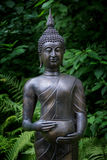 Asian statue of Buddha. Asian statue of god Buddha in forest Stock Photo