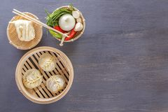 Asian steam dumplings - a traditional dish of Chinese grapes with hot vegetable appetizers. Top view. Copy space stock photography