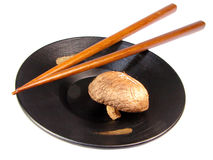 Asian still life. Japanese still life with plate chopsticks and mushrooms Stock Images