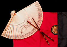 Asian still life. With fan and chopsticks royalty free stock photography