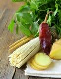 Asian Still life -  noodles, ginger, garlic and chili Royalty Free Stock Photos