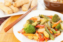 Asian Stir Fry. With broccoli, sugar snap peas, carrots, water chestnuts, red peppers, baby cob corn, and mushrooms in a tangy ginger sesame sauce. Shrimp Royalty Free Stock Photography