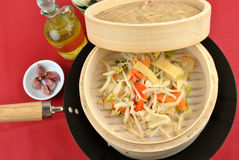 Asian stir fry mix in a bamboo steamer Stock Image