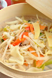 Asian stir fry mix in a bamboo steamer Stock Photo