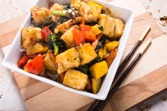 Asian Stir Fry with Tofu. An Asian stir fry with tofu, vegetables and rice Royalty Free Stock Image