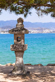 Asian Stone Lantern at the Coast Royalty Free Stock Image