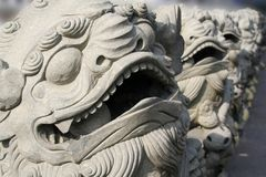 Asian stone lions. Stone lions in front of Asian temple Royalty Free Stock Photography