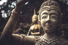 Asian stone sculptures of people symbolizing traditional culture of Thailand and Buddhism Stock Image
