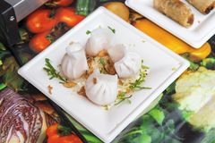 Asian Street Food Market. Asian street food, steamed Chinese dumplings, meat and vegetable food, fried onion, traditional asian dumplings served on plastic dish stock photos