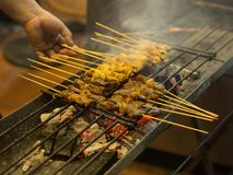 Asian street Food. People cooking, selling and buying Exotic Asi. An Food Thai, Malaysian, Chinese, Korean, Japanese. Exotic delicious Street food, especially Stock Images