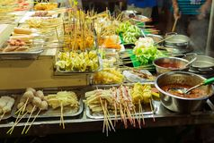 Asian street Food. People cooking, selling and buying Exotic Asi. An Food Thai, Malaysian, Chinese, Korean, Japanese. Exotic delicious Street food, especially Royalty Free Stock Images