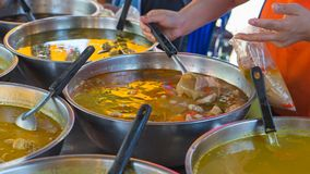 Asian street Food. People cooking, selling and buying Exotic Asi Stock Photography