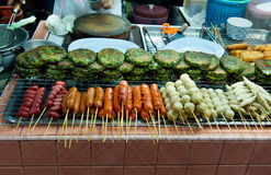 Asian street food tray with skewers Royalty Free Stock Image