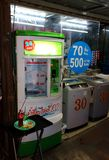 Asian street landscape. Pattaya City, Thailand - Mart 28, 2018: vending machine for sale of pure drinking water in the Asian street stock photography