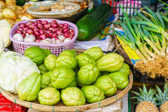 Asian street market selling chayote garlic cabbage and zucchini Royalty Free Stock Photos