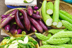 Asian street market selling Egg plant zucchini and bitter melon Stock Photos
