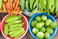Asian street market selling Little water melon and bitter gourd Royalty Free Stock Image