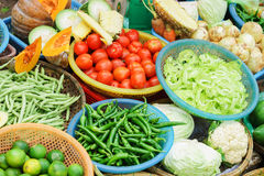 Asian street market selling tomato pepper pea pod and cabbage Stock Photo